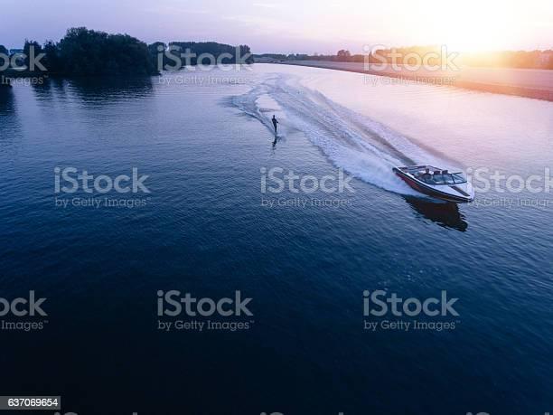 Photo of Man water skiiing on lake behind a boat