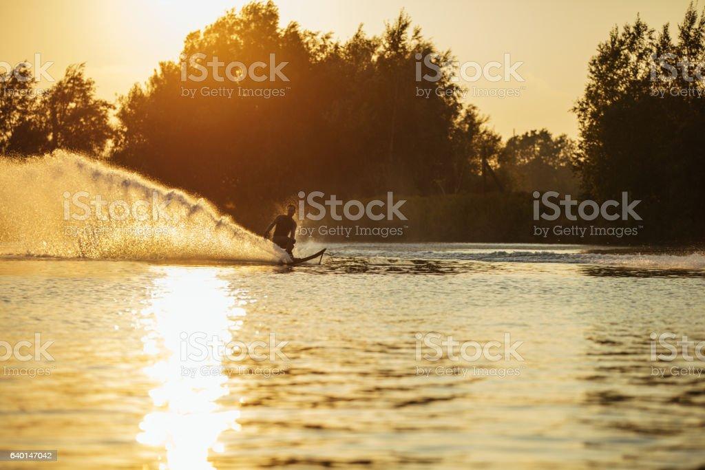 Man water skiing on lake stock photo
