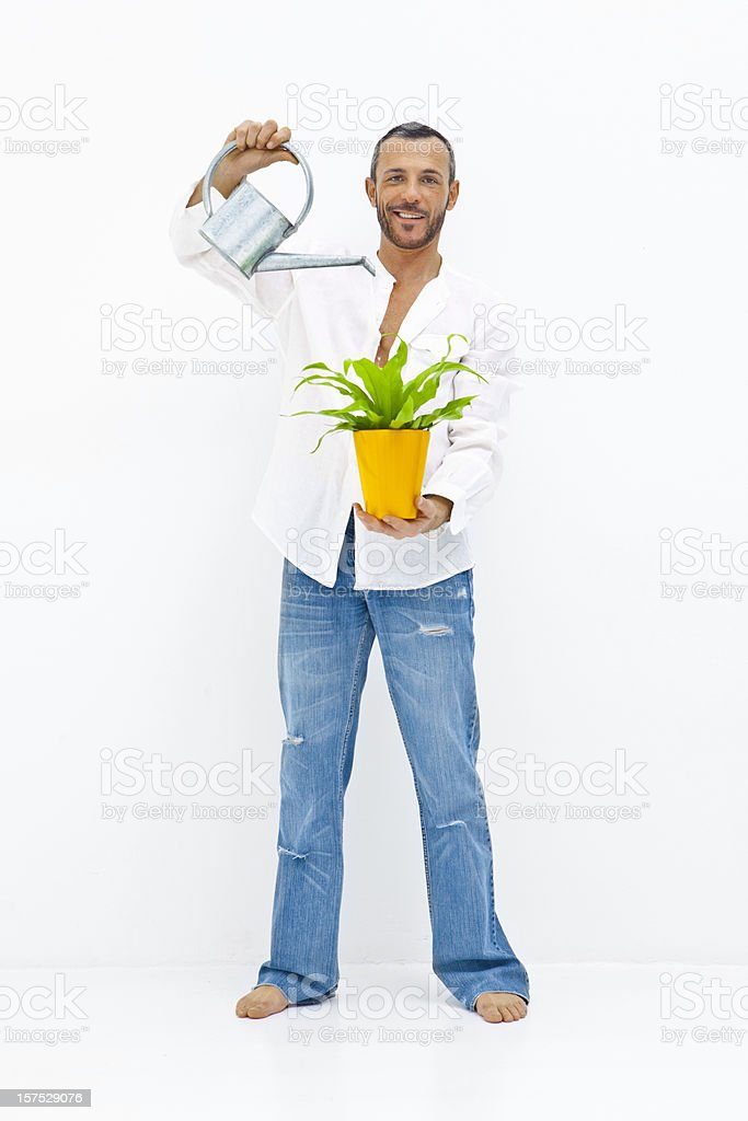 Man watering his plant royalty-free stock photo