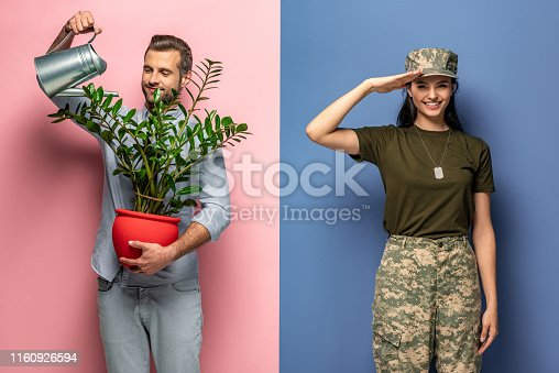 man watering plant while woman in military uniform saluting on blue and pink