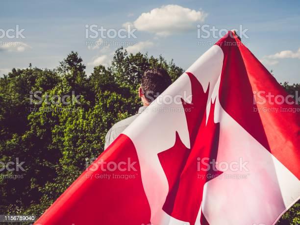 Photo of Man waving a Canadian Flag. National holiday