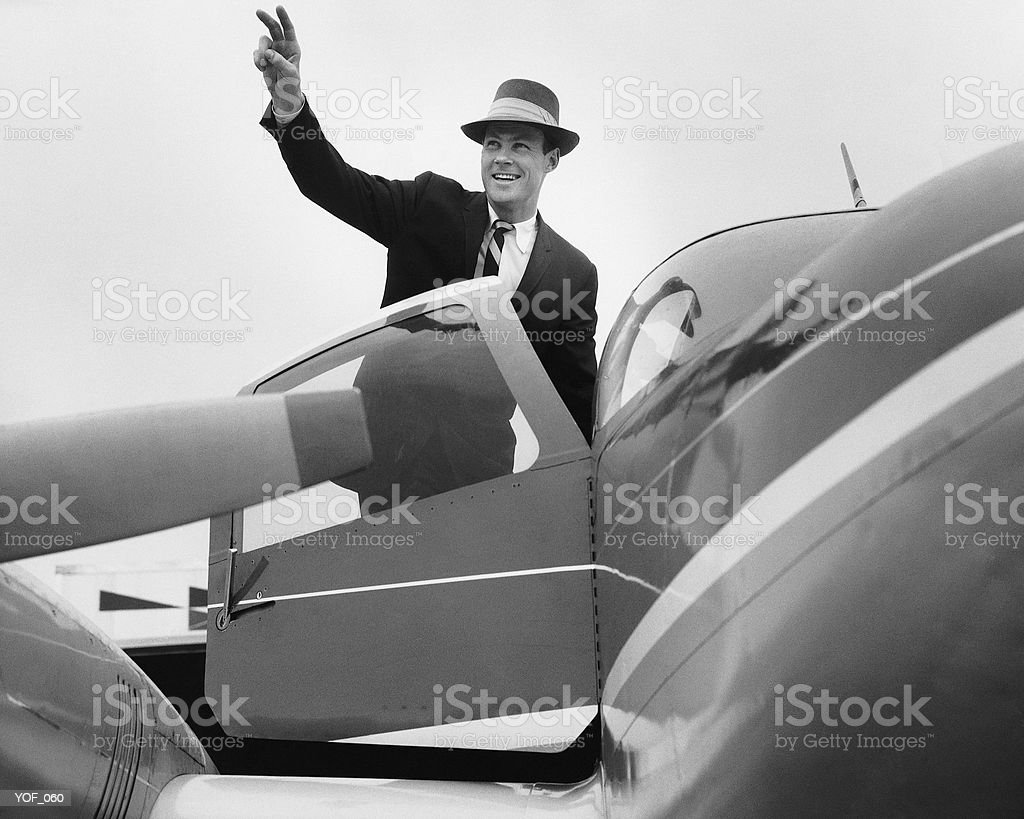 Man waving, getting in plane royalty-free stock photo