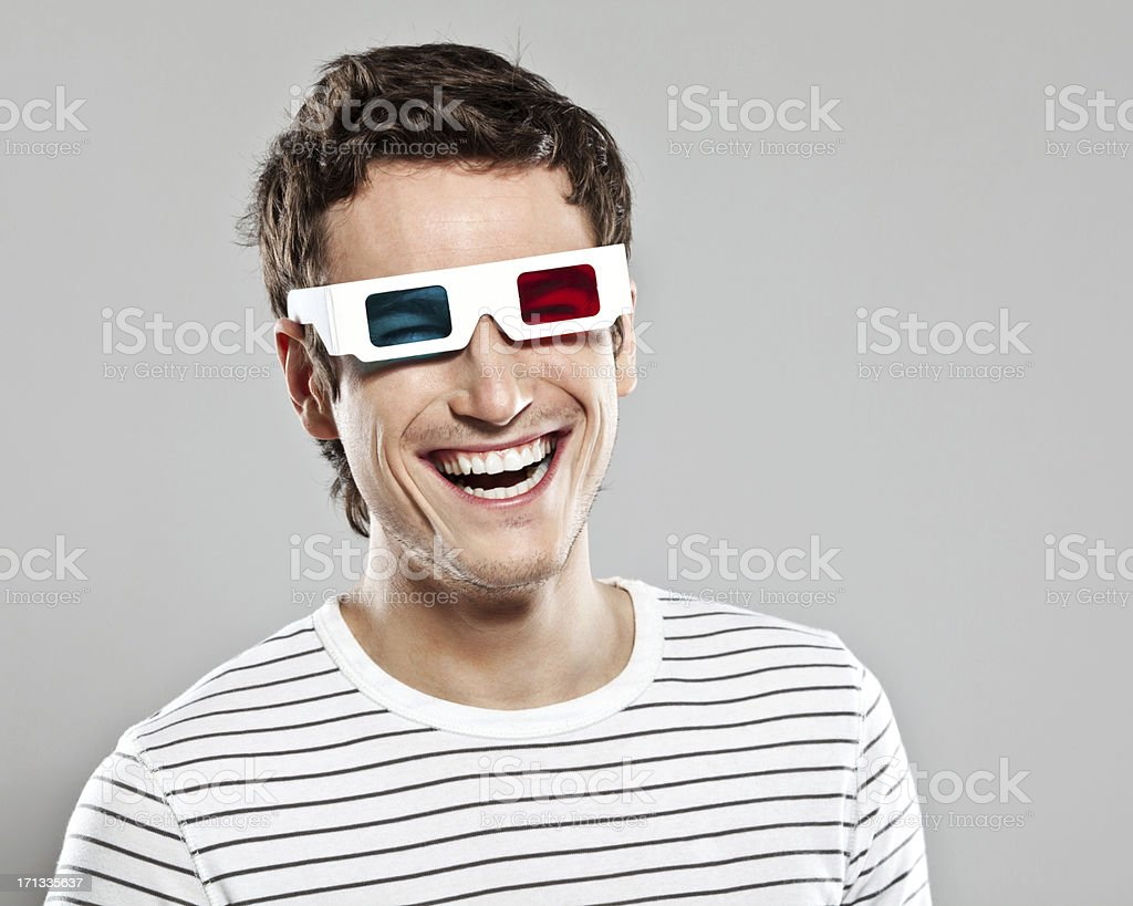Man wearing 3D glasses stock photo