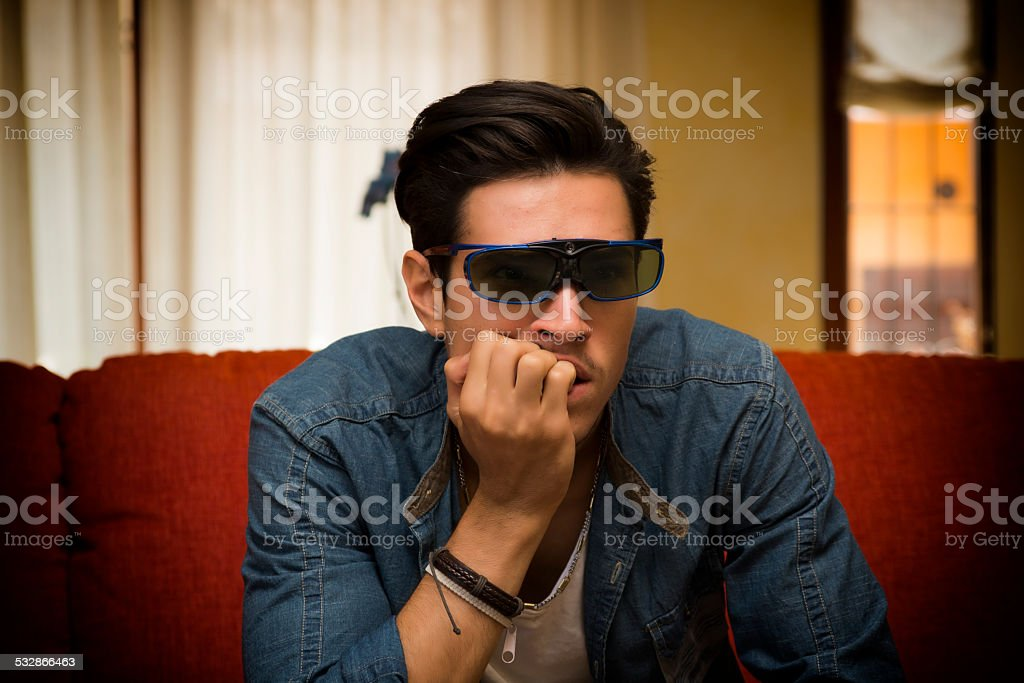 Man wearing 3d glasses sitting watching a video stock photo