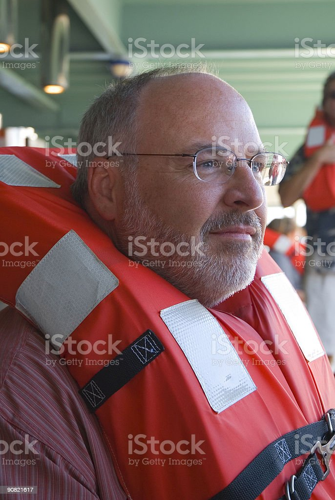 Man Wearing a Cruise Ship Life Vest royalty-free stock photo