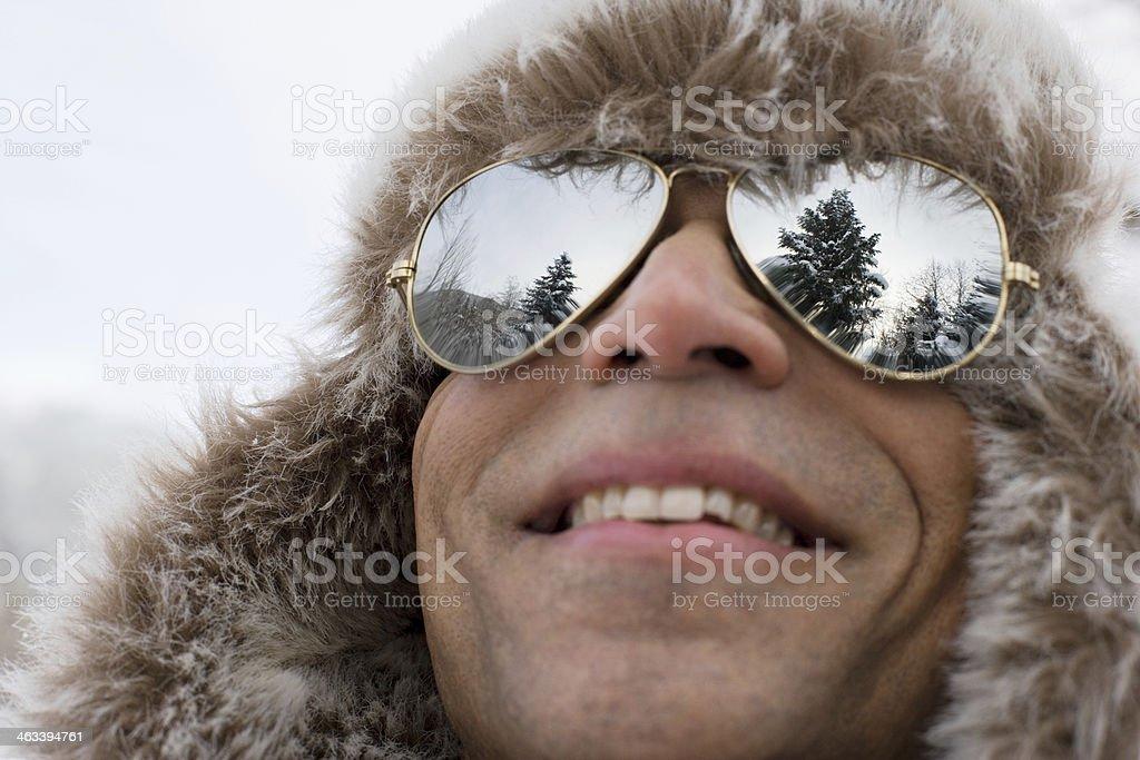 Man wearing a deerstalker hat and sunglasses stock photo