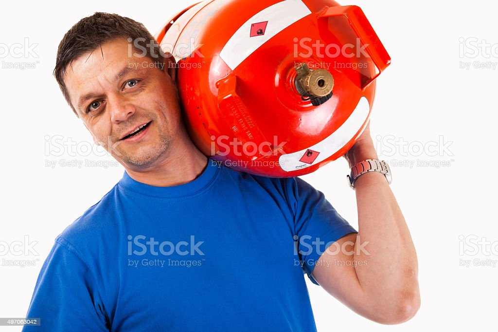 Man wearing a gas cylinder on his shoulder - isolated stock photo