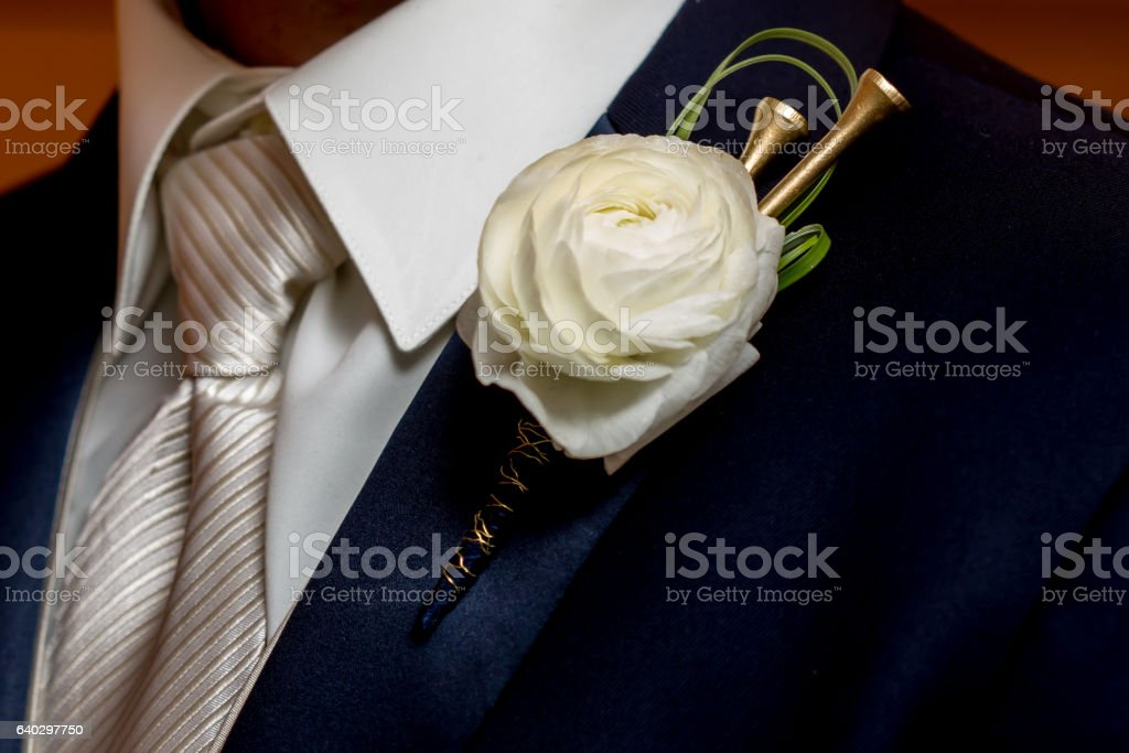 Man Wearing A Golf Tee Rose Boutonniere stock photo