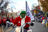 Man wearing a Grinch Mask