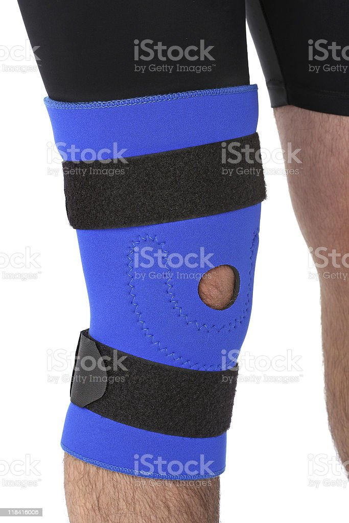 Man wearing a leg brace stock photo