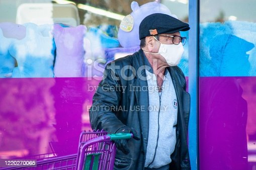 Venice Beach, CA, USA April 14, 2020 Man wearing a mask to go shopping at a grocery story with mask and gloves due to the Corona virus outbreak