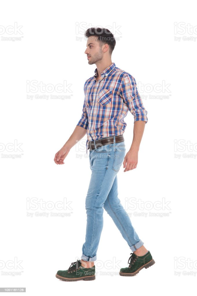 0609e4581b Man Wearing A Shirt With Red Checkers Walks To Side Stock Photo ...