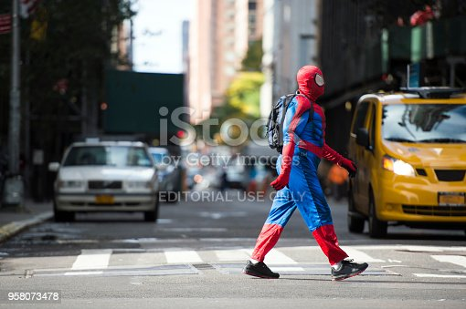 istock A man wearing a Spiderman costume is walking through the streets of Manhattan in New York City, USA. 958073478