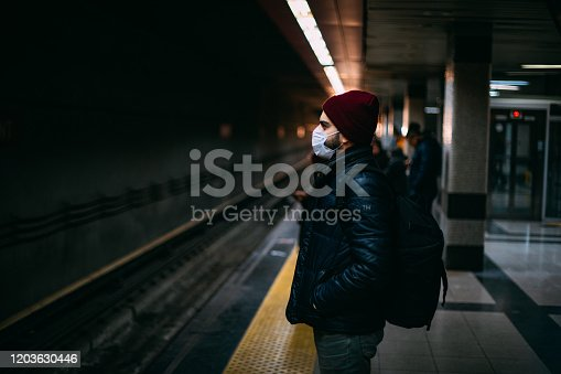 istock Man Wearing a Sterile Mask in the Subway 1203630446