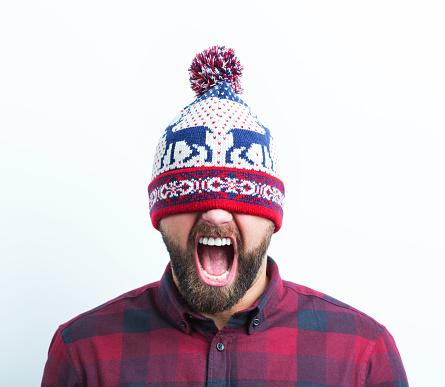 Man Wearing A Winter Cap Shouting Stock Photo - Download Image Now