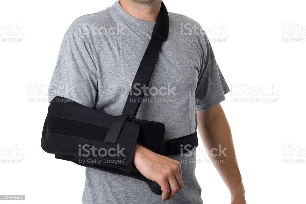 Hombre usando un aparato ortopédico brazo sobre blanco - foto de stock