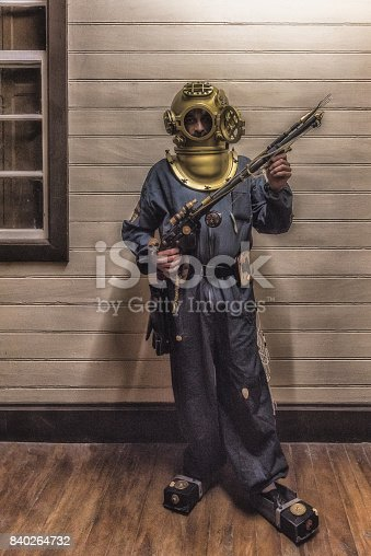 Man wearing an old diving equipment with helmet  during a Steampunk convention in Paranapiacaba, Sao Paulo, Brazil