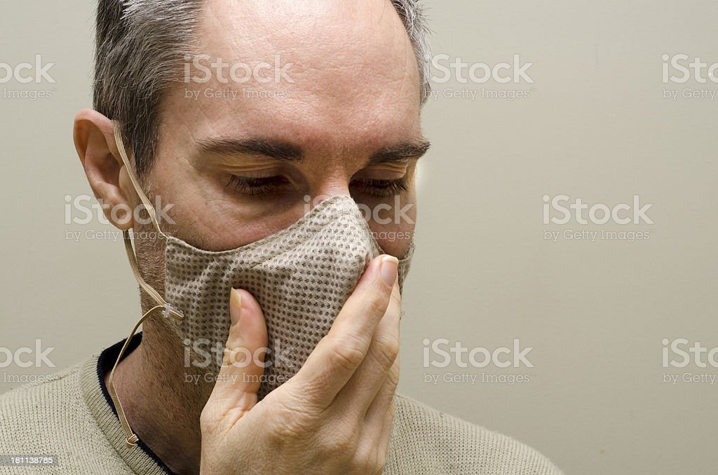 man wearing and Allergy Mask stock photo