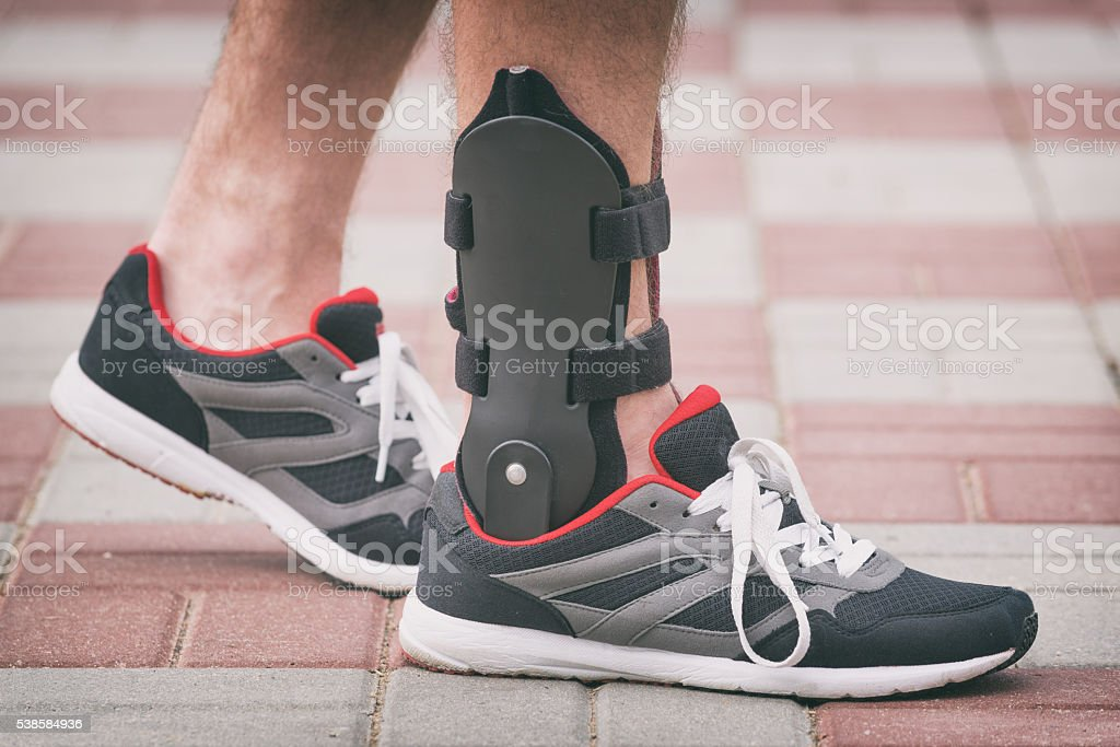 Man wearing ankle brace stock photo