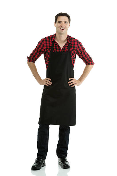 man wearing apron with arms crossed - apron stock pictures, royalty-free photos & images