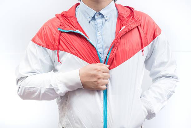 man wearing blue shirt and windbreaker jacket full zip hoodie - zip hoodies stock-fotos und bilder