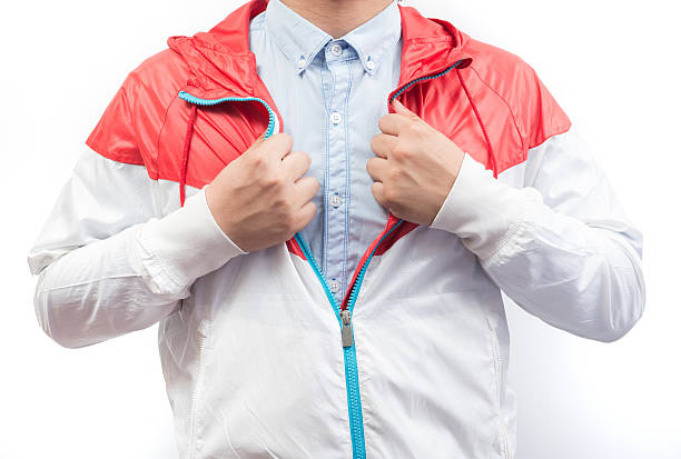man wearing blue shirt and windbreaker jacket full zip hoodie - zip hoodies stock-fotos und bilder