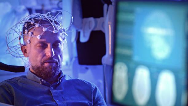 Man Wearing Brainwave Scanning Headset. stock photo