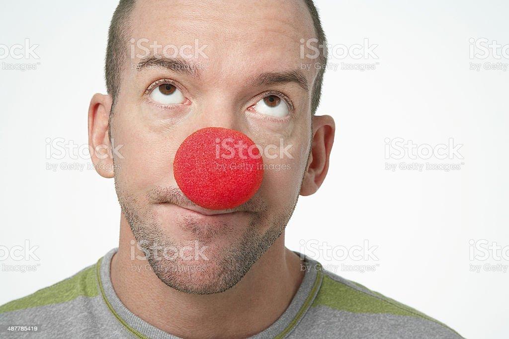 Man Wearing Clown Nose stock photo