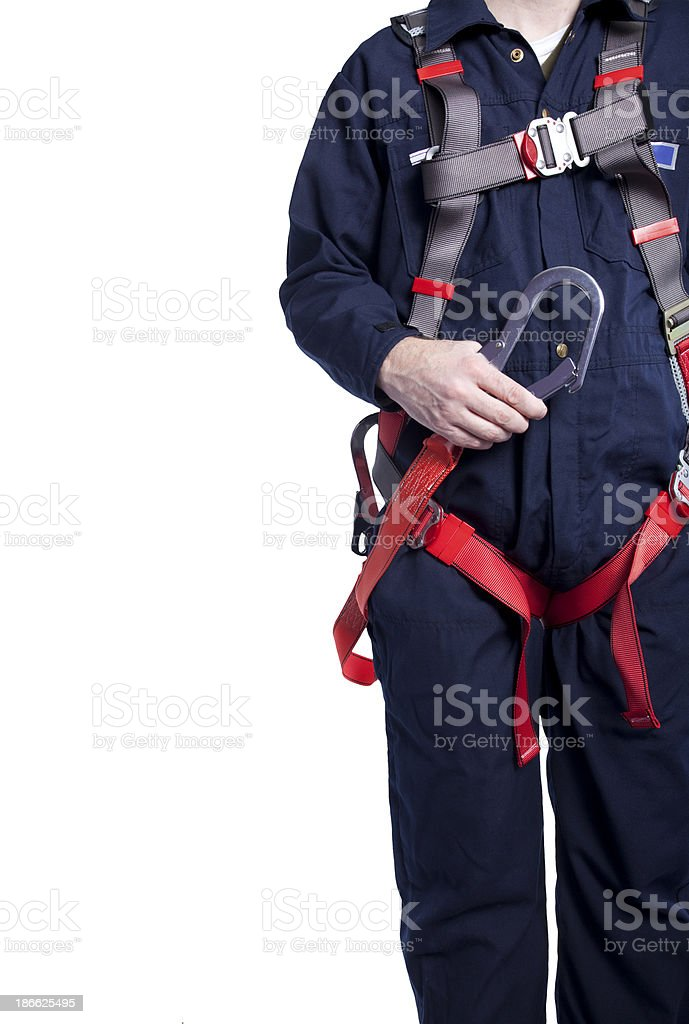 man wearing coveralls and fall protection equipment stock photo
