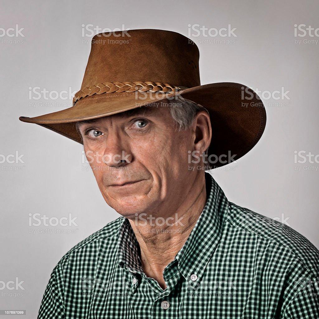 Man wearing cowboy hat stock photo