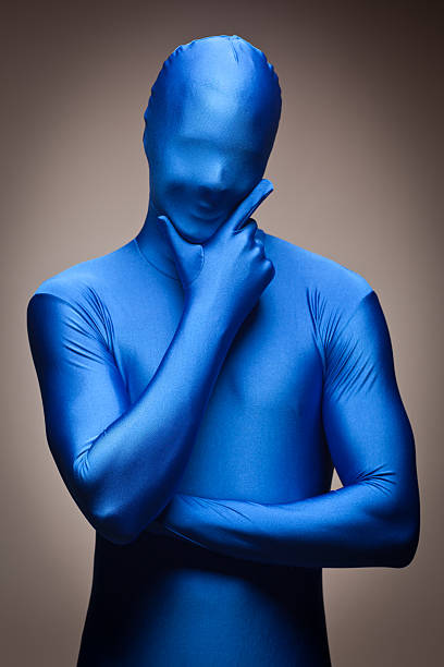 man wearing full blue nylon bodysuite - leotard stock pictures, royalty-free photos & images