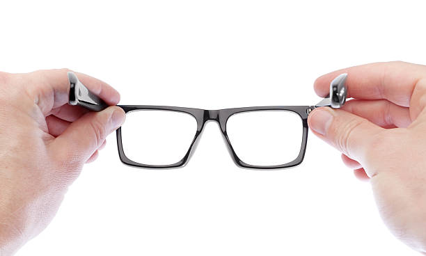 Man wearing glasses to improve vision. On a white background. stock photo