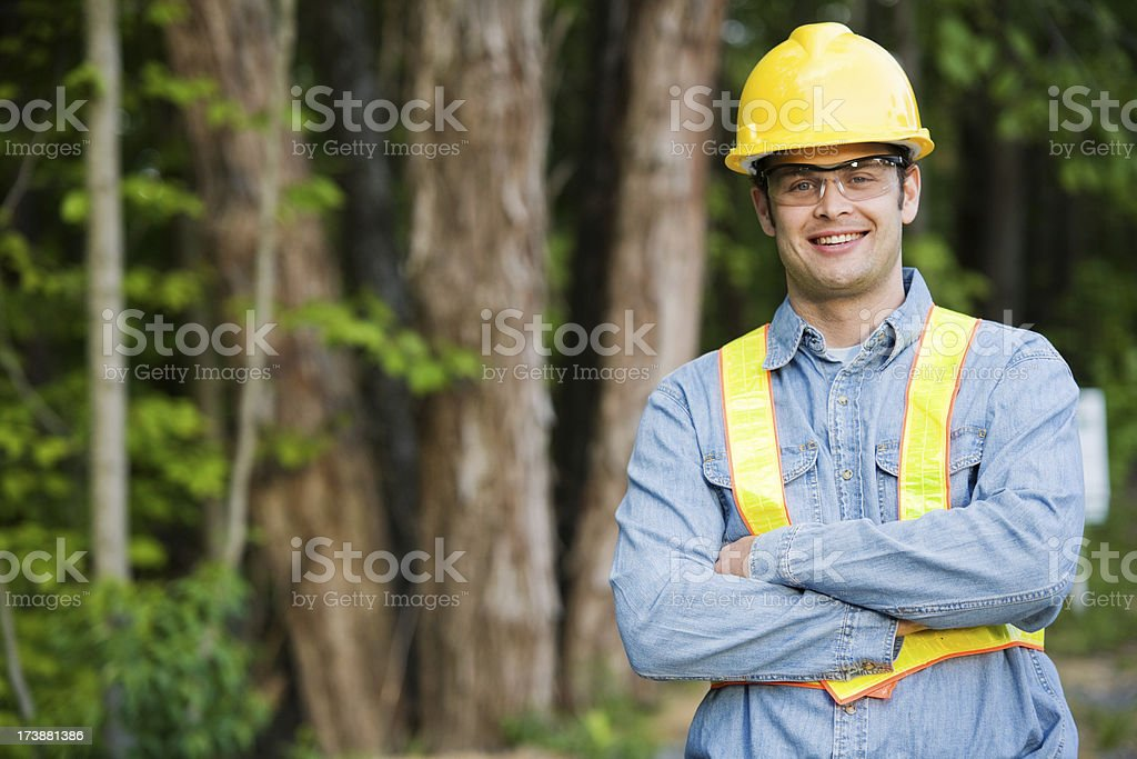 Man Wearing Hard Hat and Safety Vest stock photo