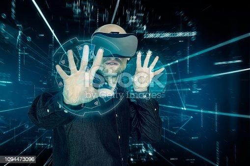Virtual reality simulator. Man looking around in virtual reality. Spy equipment