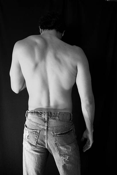 Man Wearing Jeans Man back in jeans -Black and White- hot sexy butts stock pictures, royalty-free photos & images