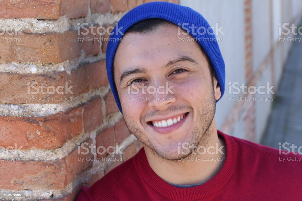 Man wearing knit hat outdoors stock photo