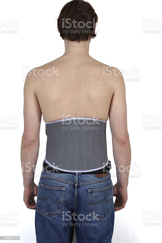 Man wearing  lumber support belt. royalty-free stock photo