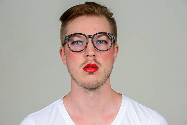 man wearing make up - transvestite stock photos and pictures