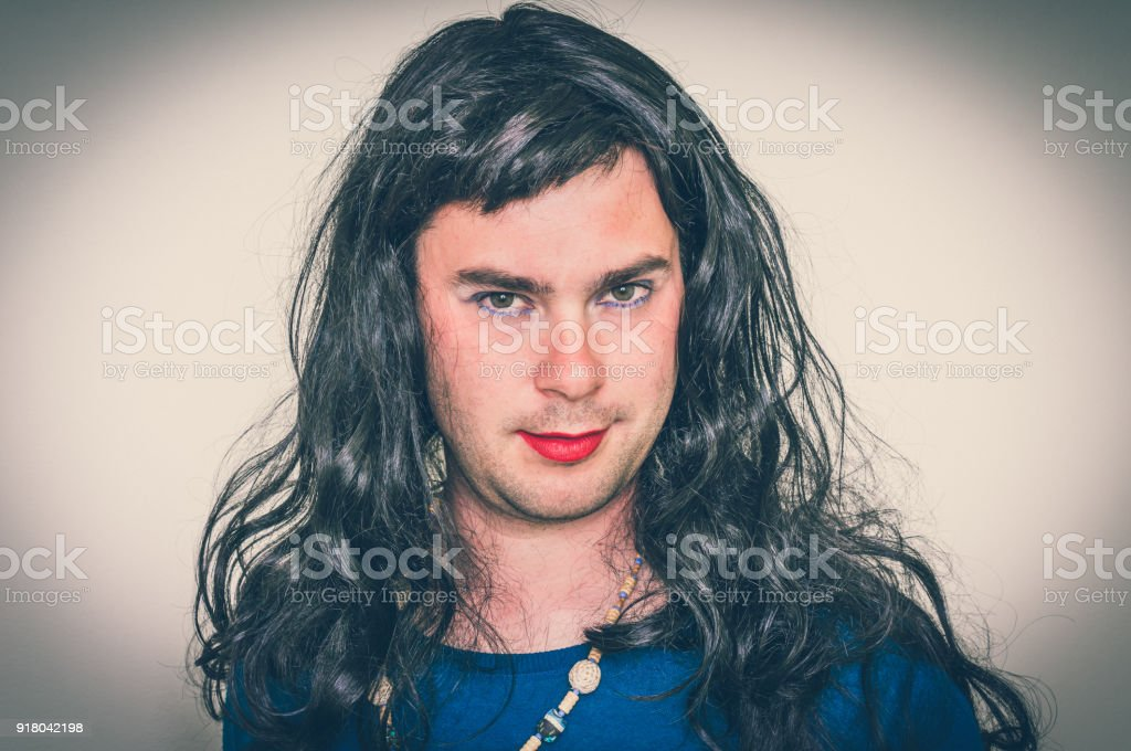 Man wearing makeup and dress looks like as a woman stock photo