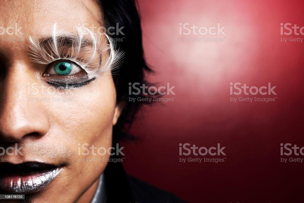 Man Wearing Make-up and Feather Eyelashes royalty-free stock photo