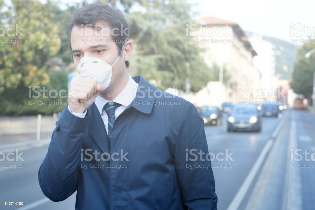 Man wearing mask against smog air pollution – zdjęcie