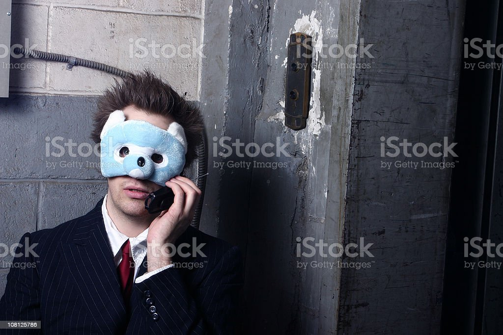 Man Wearing Mask and Talking on Phone royalty-free stock photo