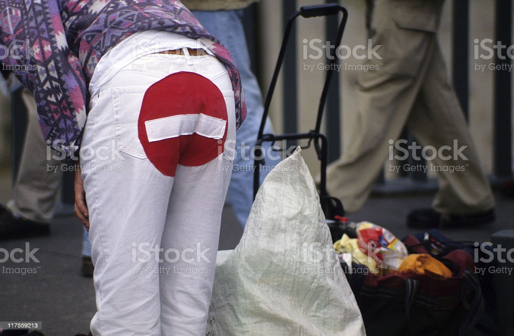 Man wearing no-entry sign trousers, rear view, Paris, France royalty-free stock photo