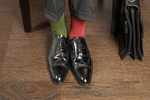 Man wearing odd socks stock photo
