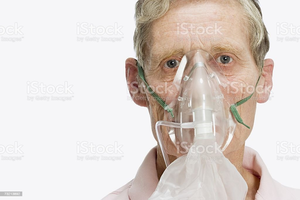 Man wearing oxygen mask stock photo