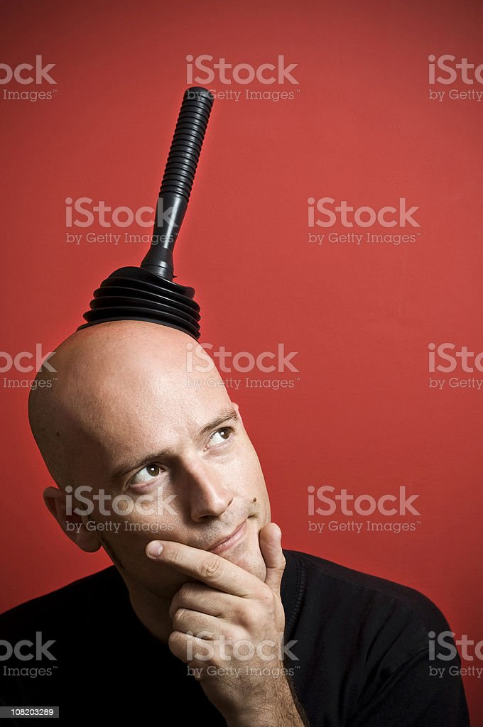 Man Wearing Plunger on Head and Thinking royalty-free stock photo