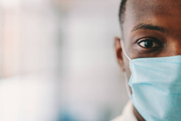 Man wearing protective face mask during COVID-19 pandemic stock photo