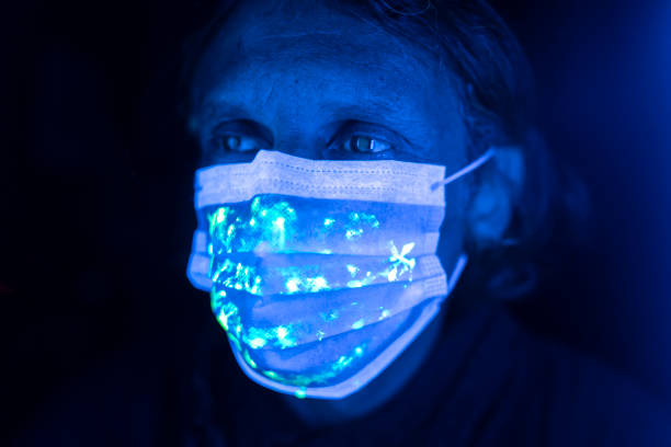 Man wearing protective face mask stock photo
