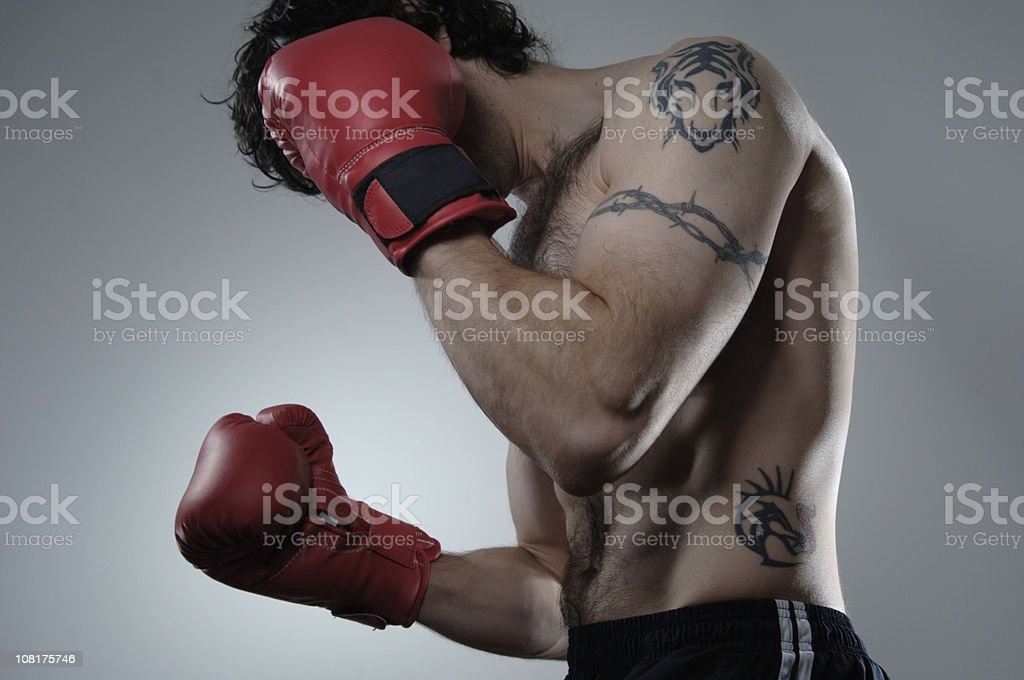 Man Wearing Red Boxing Gloves royalty-free stock photo