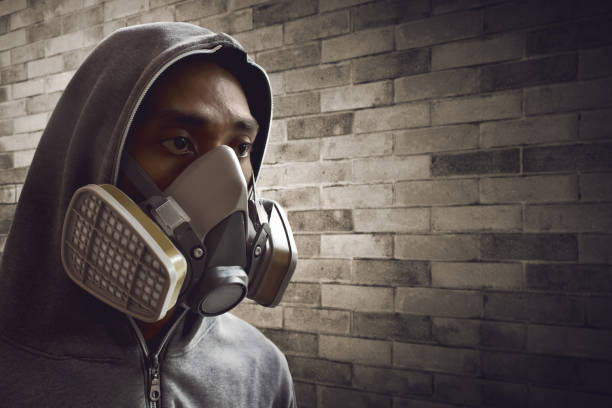 Royalty free cool gas mask pictures images and stock photos istock man wearing respirator mask stock photo voltagebd Images